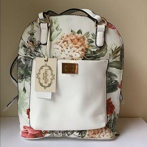 White flower print vegan leather backpack